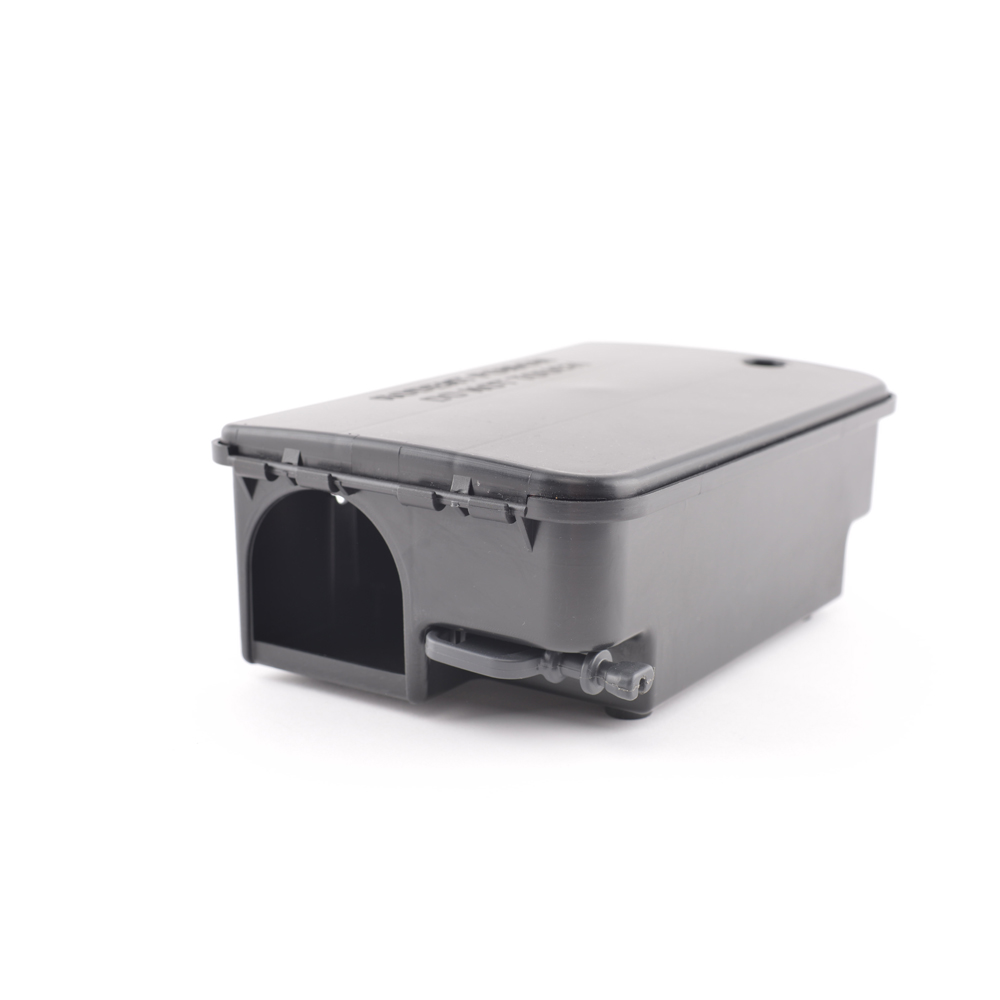 Rat bait box with lid opening to one side